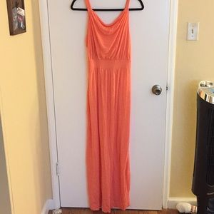Full length coral/pink dress with draped neckline